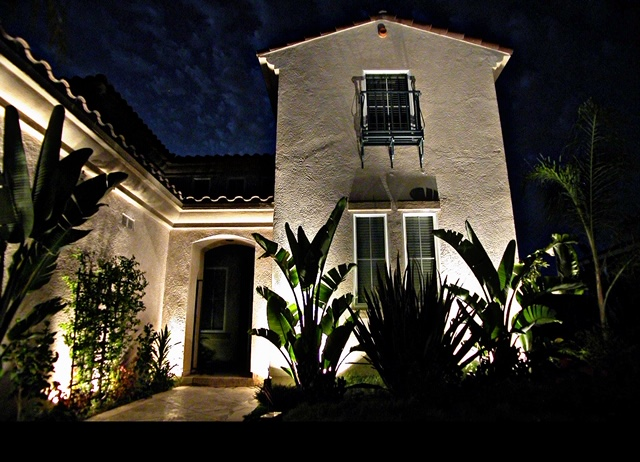 Residential landscape lighting on two-story home