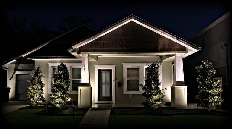 Residential landscape lighting of home at night