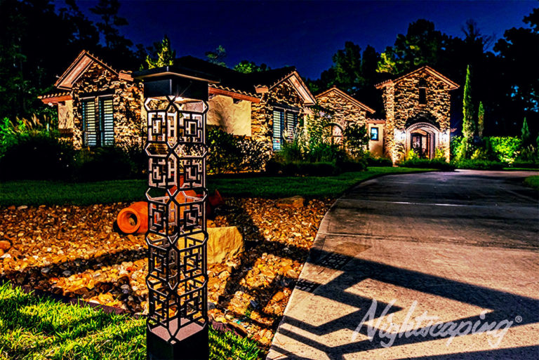 Outdoor residential lighting for large home at night
