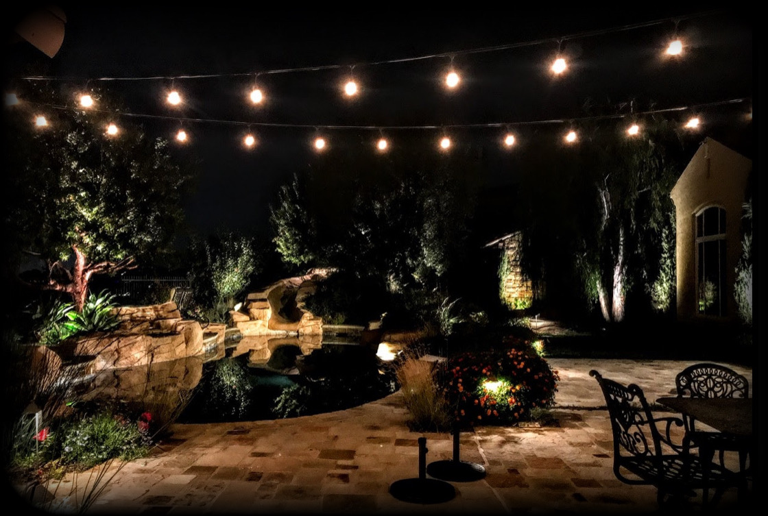 A backyard nicely lit up at night